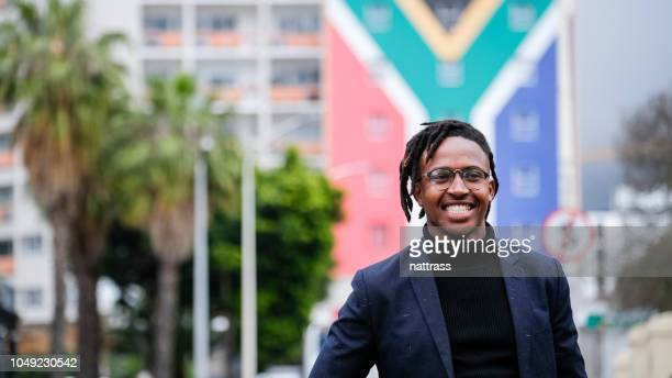 successful african entrepreneur - south african flag stock photos and pictures