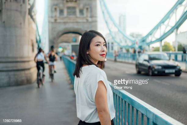 successful and cheerful businesswoman in the city - females stock pictures, royalty-free photos & images