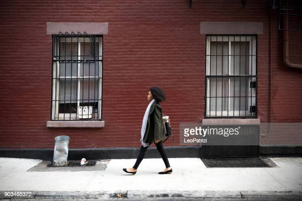 Successful and elegant woman walks the streets of New York