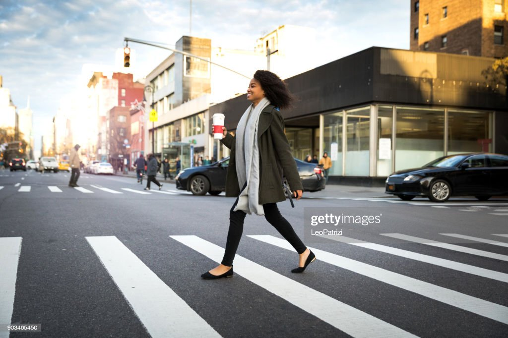 Successful and elegant woman walks the streets of New York : Stock Photo