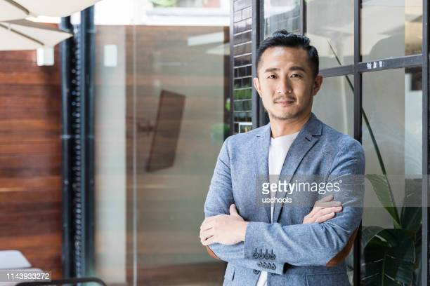 successful asian businessman in a modern coworking space - 35 year old man stock pictures, royalty-free photos & images
