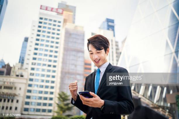 successful asian businessman in modern city - east asian ethnicity stock pictures, royalty-free photos & images