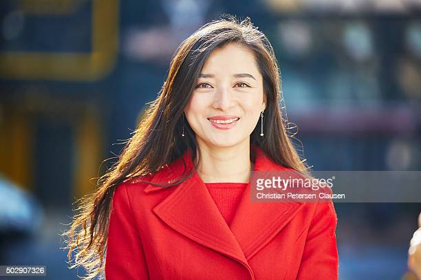 Successful asian businesswoman with long hair smiling