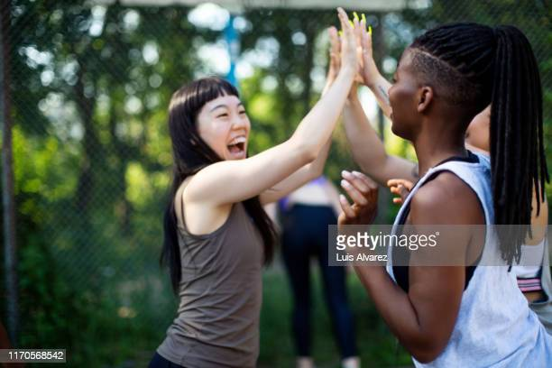 successful basketball players celebrating the victory - mid adult women stock pictures, royalty-free photos & images
