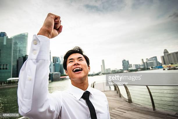 Successful business man against the skyscraper in singapore