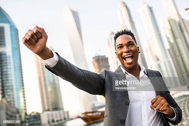 Successful business man against the skyscraper