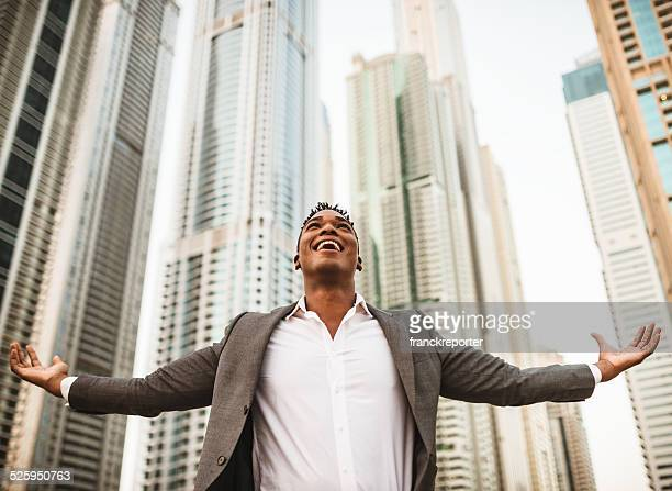 successful business man against the skyscraper - arms outstretched stock pictures, royalty-free photos & images