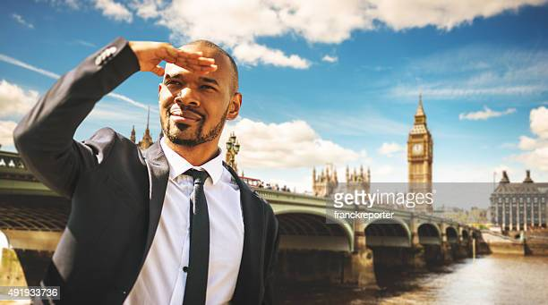 Successful business man looking away against the london skyline