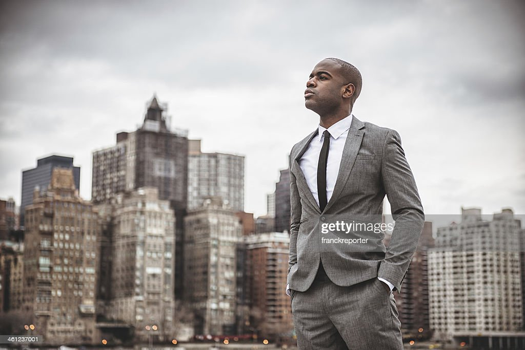 Successful business man looking away against the skyline : Stock Photo