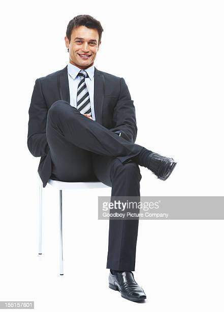 successful business man sitting and looking confident - sitting stockfoto's en -beelden