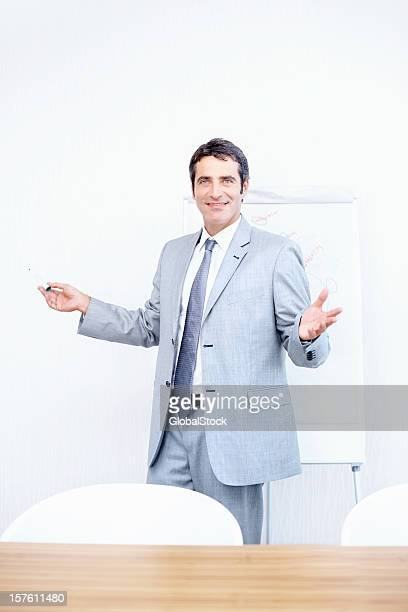 Successful business manager in board room
