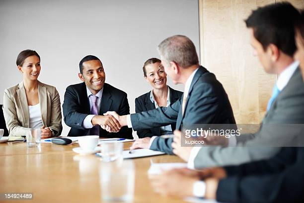 Successful business people shaking hands after a meeting