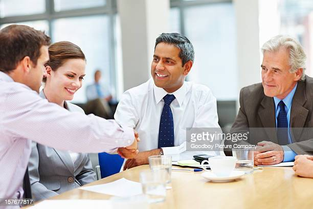 Successful business people shaking hands at board room