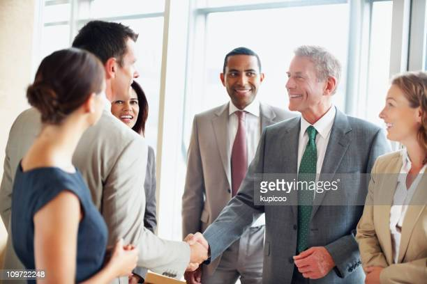 Successful business people shaking hands to fix deal at office