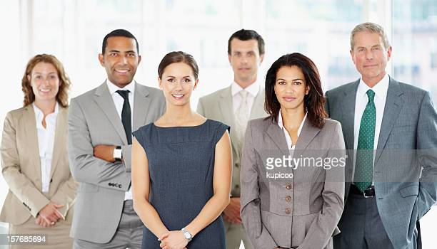 Successful business people standing together at office