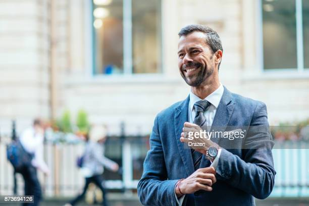 successful business person expressing positive emotion - ricchezza foto e immagini stock