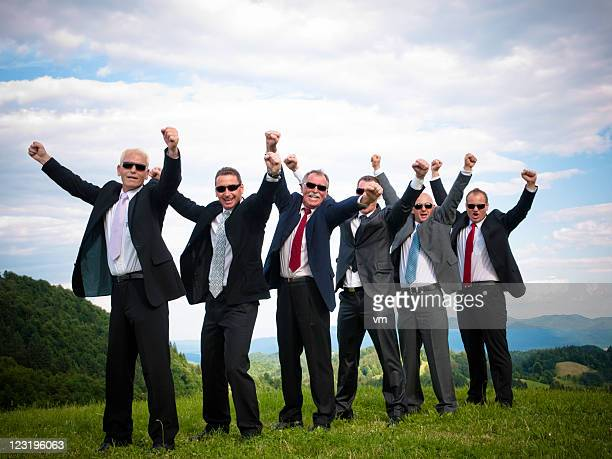 Successful Business Team Raising Fists