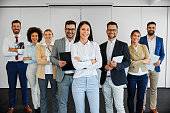 successful business team smiling teamwork corporate office colleague