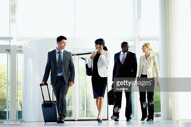 Successful business travelers walking at an airport ready to check-in