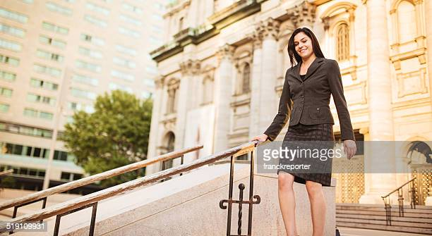 successful business woman walking on the city