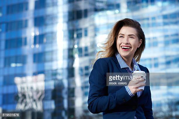 successful business woman with her coffee