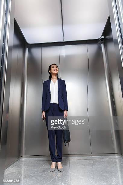 Successful business women in the elevator