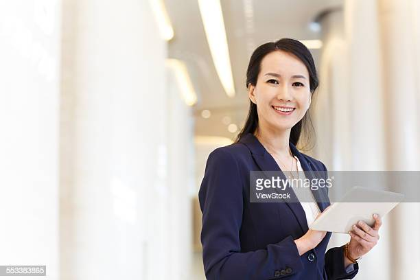 Successful business women use flat computer