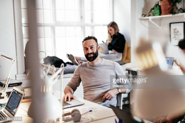 successful businessman in shared office - scandinavia stock pictures, royalty-free photos & images