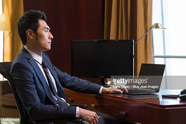 Successful businessman thinking in study
