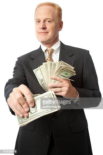 Successful businessman with cash in hand