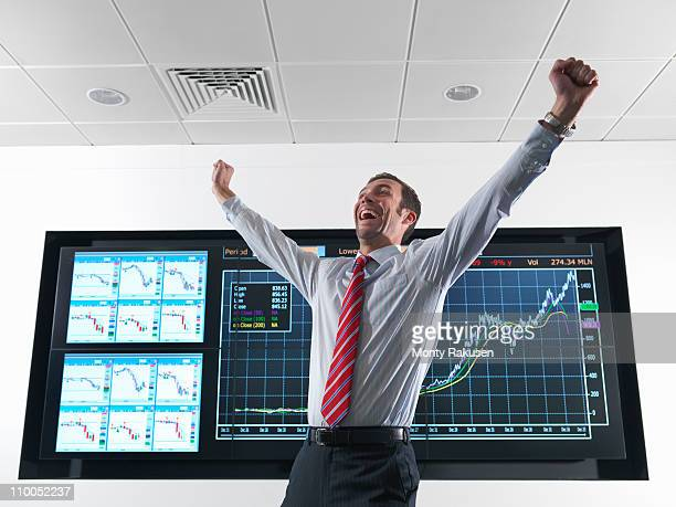 Successful businessman with graphs