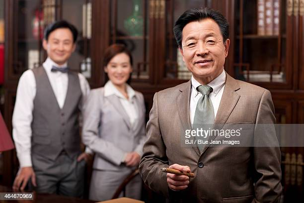 Successful businessman with team in background