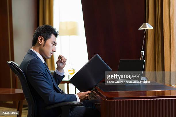 Successful businessman working in study