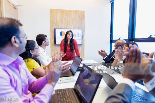 successful businesswoman applauded by her colleagues - indian culture stock pictures, royalty-free photos & images
