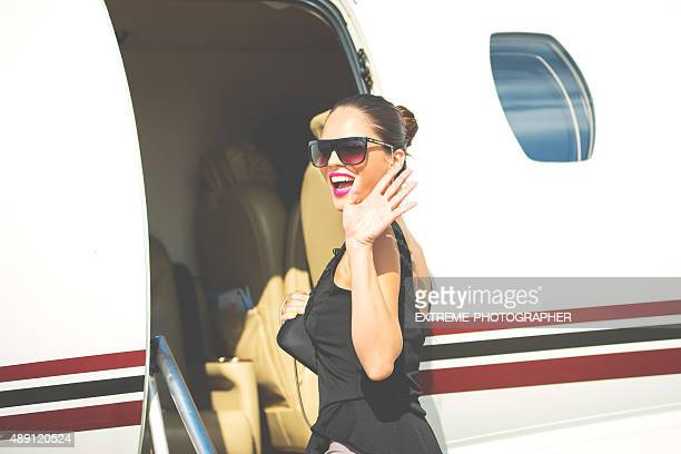 Successful businesswoman entering private jet airplane