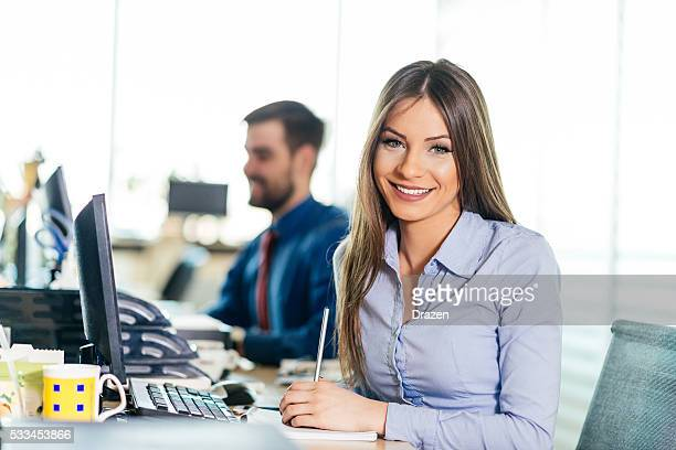 Successful businesswoman in office, proud on her latest results