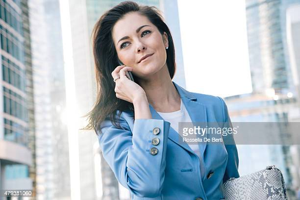 Successful Businesswoman On The Phone In Urban Landscape