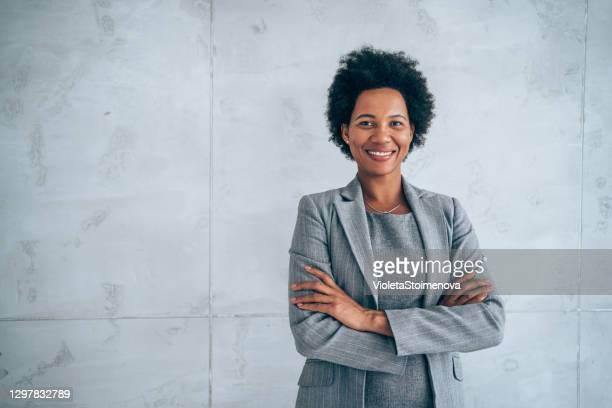 successful businesswoman - gray suit stock pictures, royalty-free photos & images