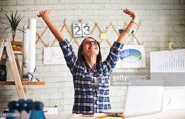 successful  businesswoman. - arms raised stock pictures, royalty-free photos & images