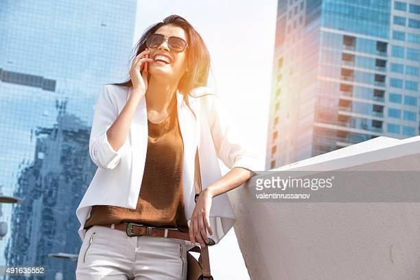 Successful businesswoman talking on phone in Dubai