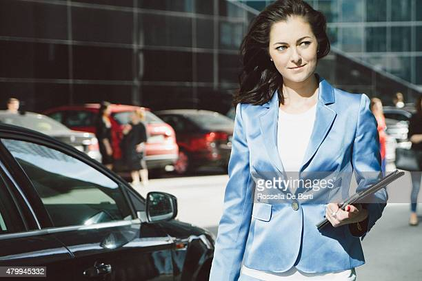 Successful Businesswoman Walking Down The Street, Urban Landscape