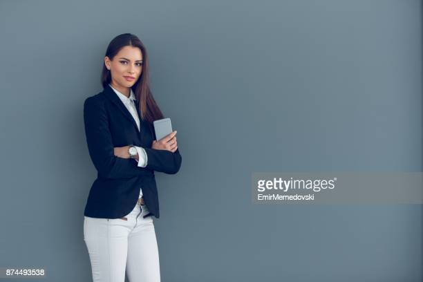 successful businesswoman with mobile phone - businesswear stock pictures, royalty-free photos & images