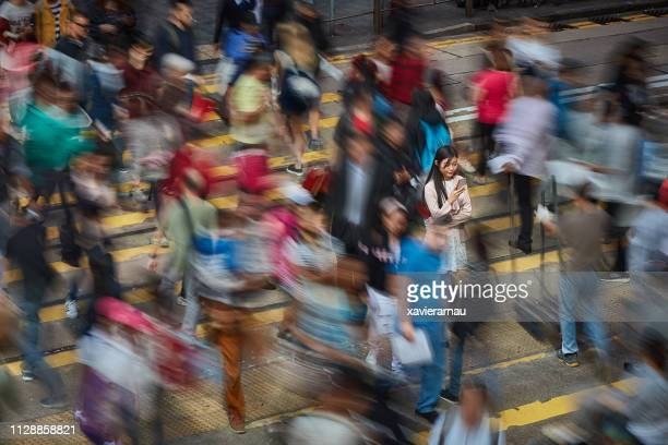 successful chinese businesswoman in the street - long exposure stock pictures, royalty-free photos & images