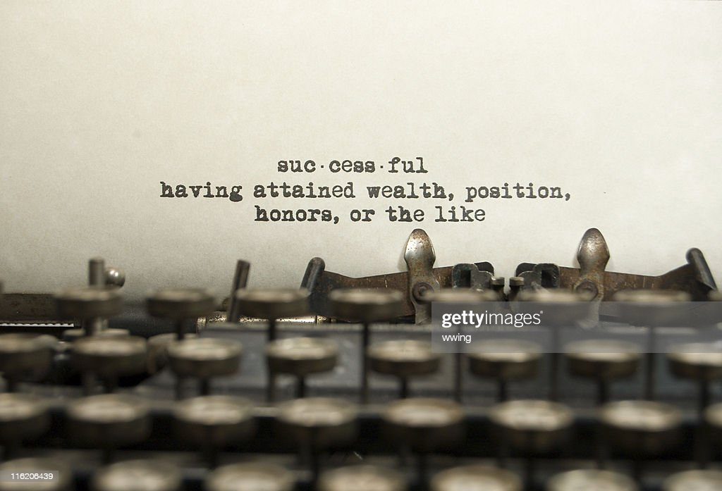 Successful definition on an old typewriter : Stock Photo