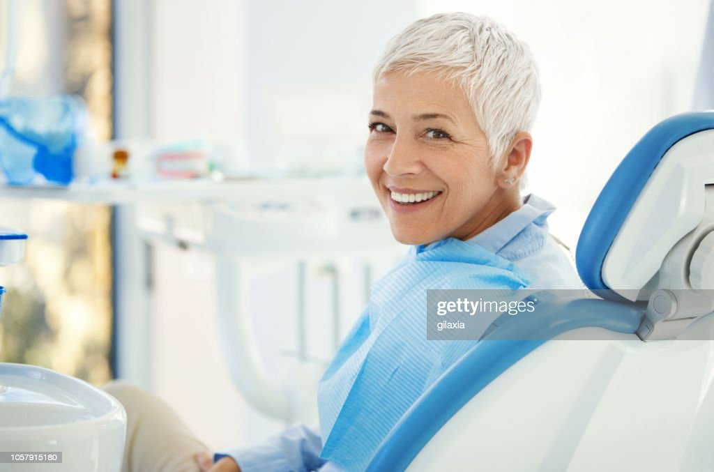 Successful dentist appointment. : Stock Photo