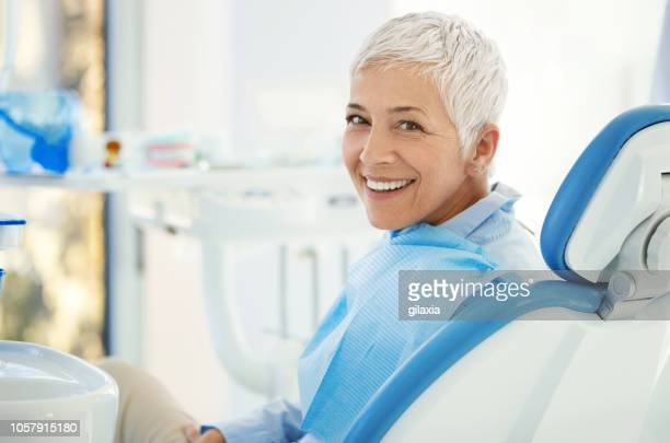 successful dentist appointment. - toothy smile stock pictures, royalty-free photos & images