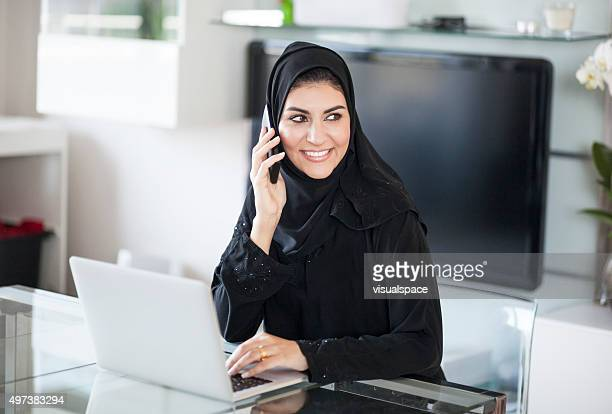 Successful Emirati Female Enterpreneur Working At Home