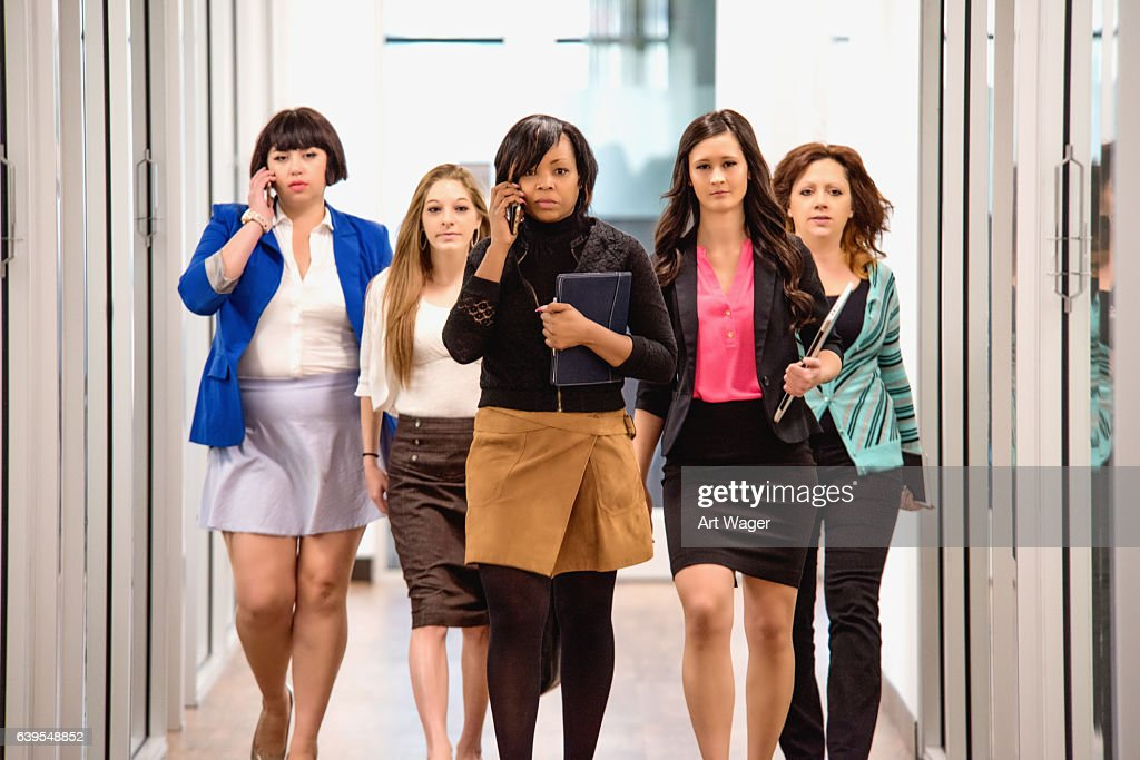 Successful Female Corporate Business Team Walking WIth Purpose : Stock Photo