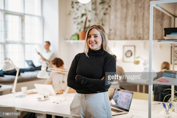 successful female entrepreneur in co-working space - employee engagement stock pictures, royalty-free photos & images