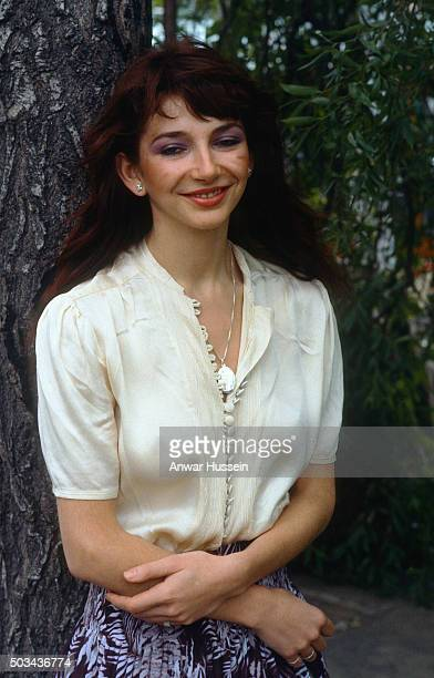Successful female vocalist Kate Bush poses by a tree on January 01, circa 1985 in London, England.
